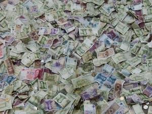 13918264820_fe7d343d8d_o Pile of Yuan